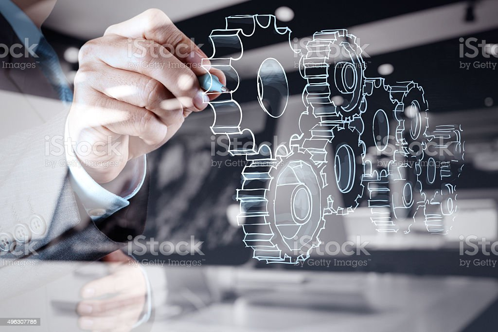 businessman hand draws gear to success concept stock photo