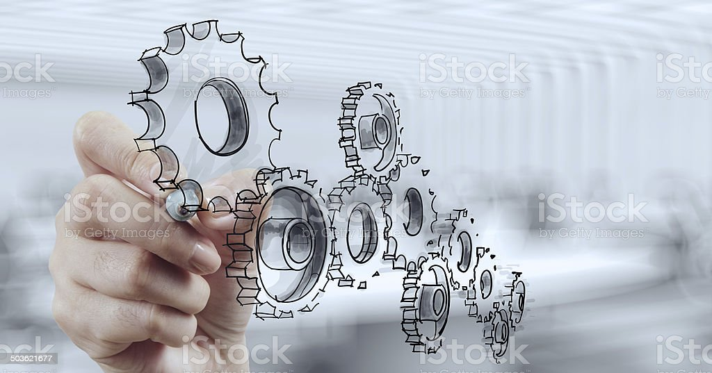 businessman hand draws gear to success stock photo