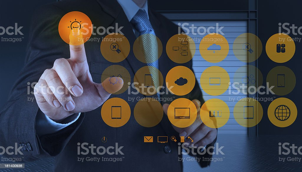 businessman hand draws lightbulb with new computer interface as royalty-free stock photo