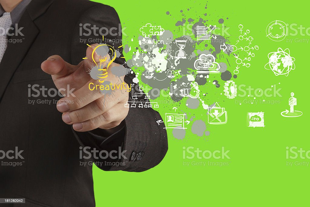 businessman hand draws lightbulb with new computer interface royalty-free stock photo
