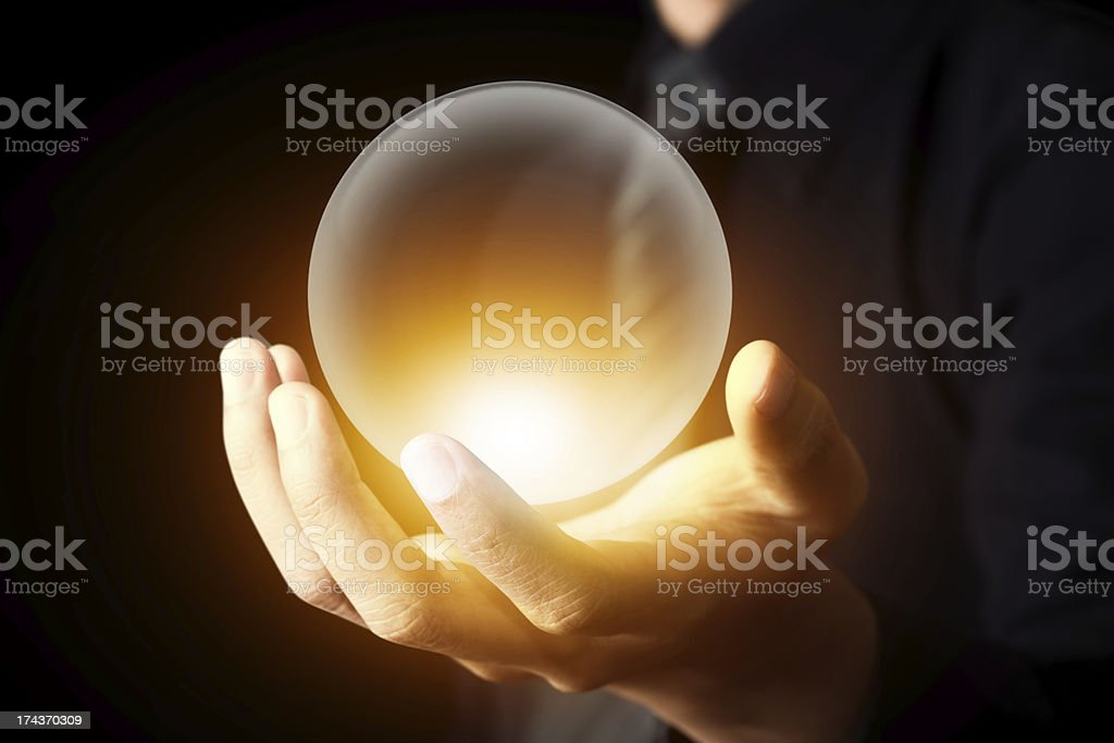 Businessman hand holding a Crystal Ball stock photo
