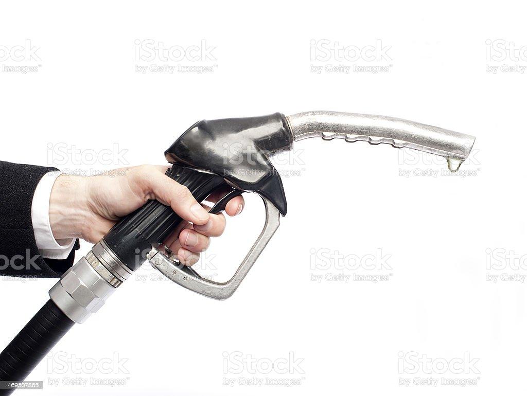 businessman hand holding a fuel pump stock photo