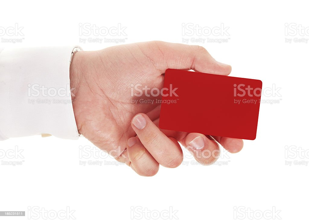 Businessman hand holding a red card on white stock photo
