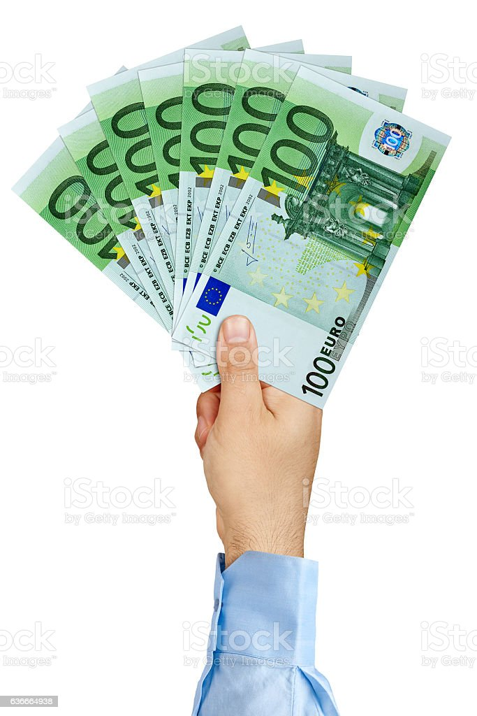Businessman hand holding fan of 100 Euro Banknotes isolated stock photo