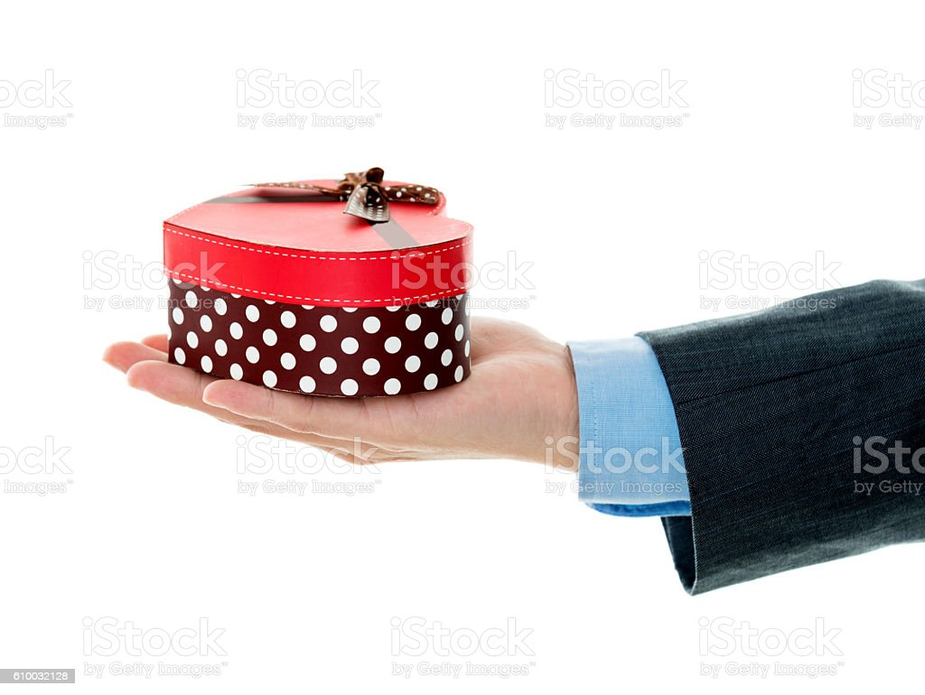 Businessman hand holding gift box stock photo