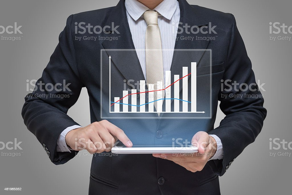 Businessman hand holding tablet graph finance isolated stock photo