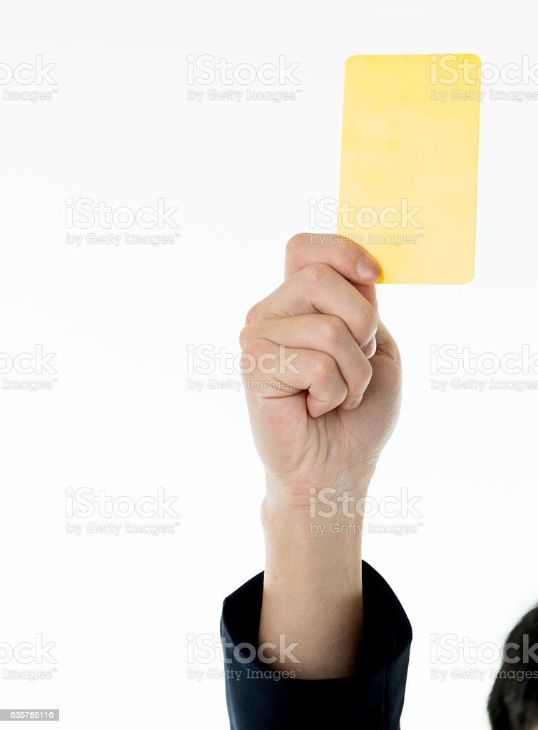 Businessman hand holding yellow card stock photo