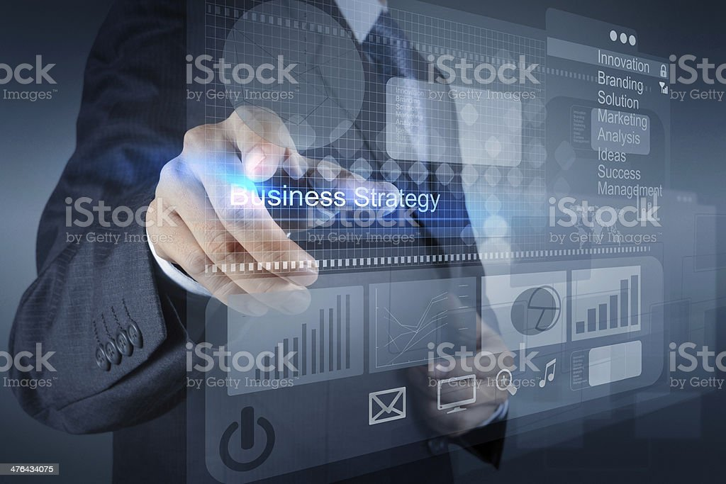 businessman hand points to business strategy royalty-free stock photo