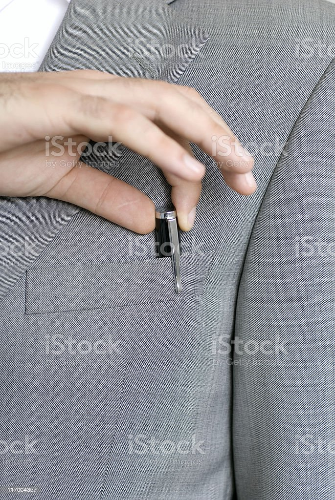 Businessman Hand Pulls Pen from Suit Pocket royalty-free stock photo