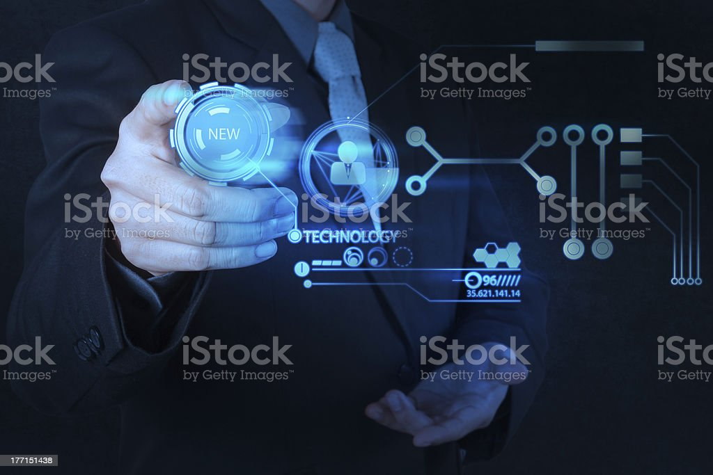 businessman hand pushing  new technology button on modern comput stock photo