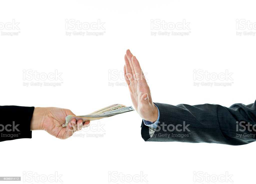 Businessman hand refusing an offering of money from another pers stock photo