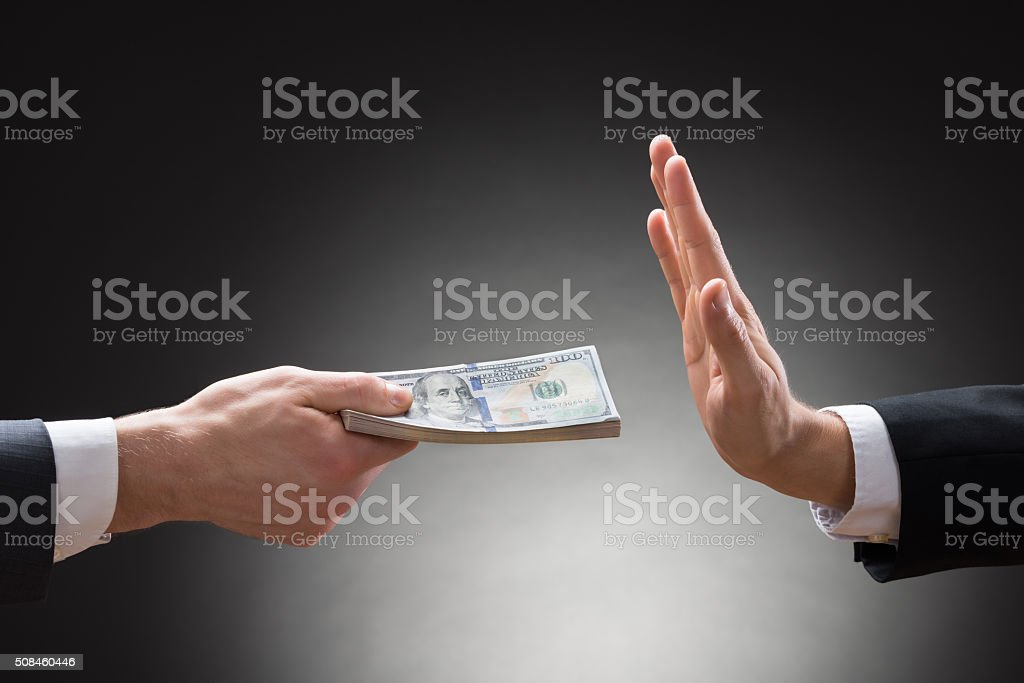 Businessman Hand Rejecting An Offer Of Money stock photo