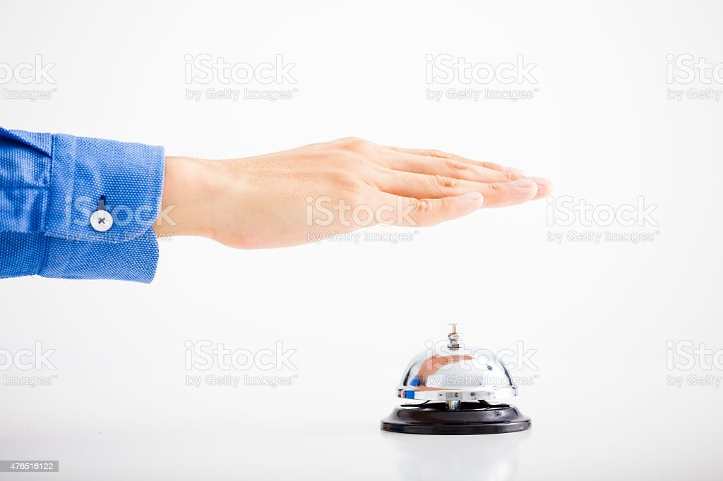 Businessman hand ringing the bell for assistance stock photo