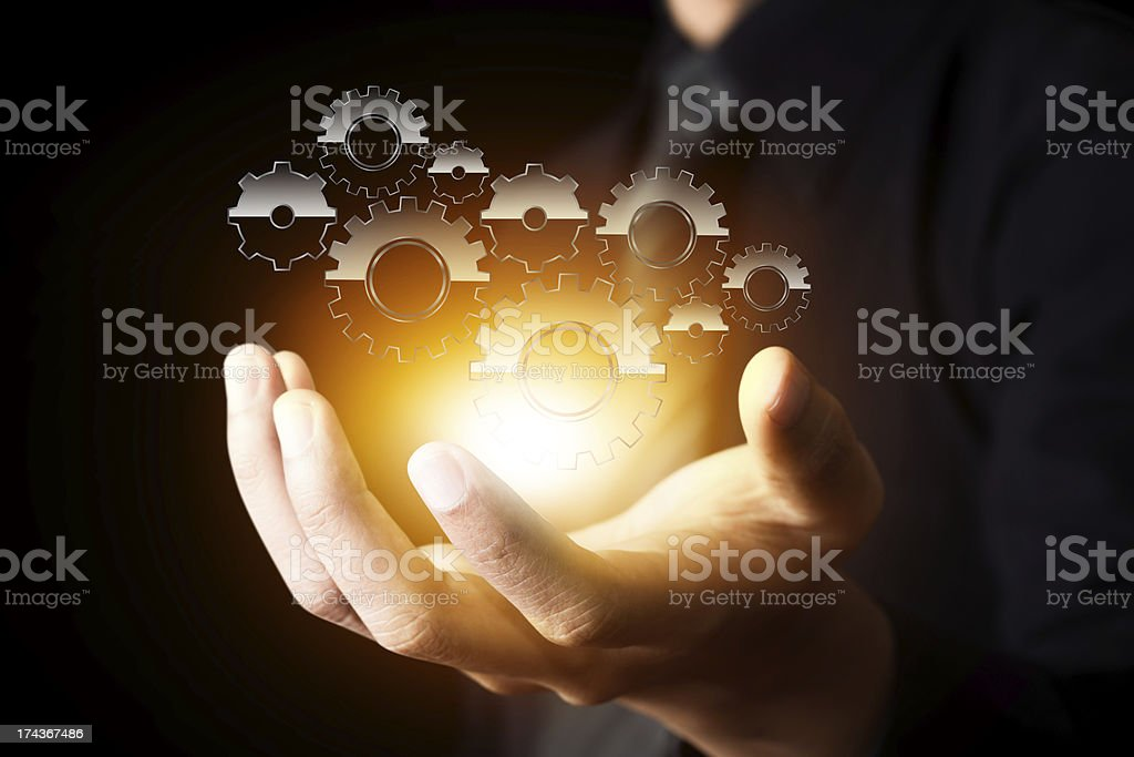 businessman hand show gear to success as concept stock photo
