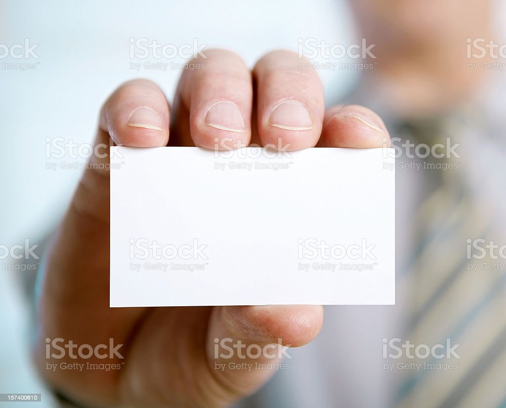 Businessman hand showing a blank card stock photo