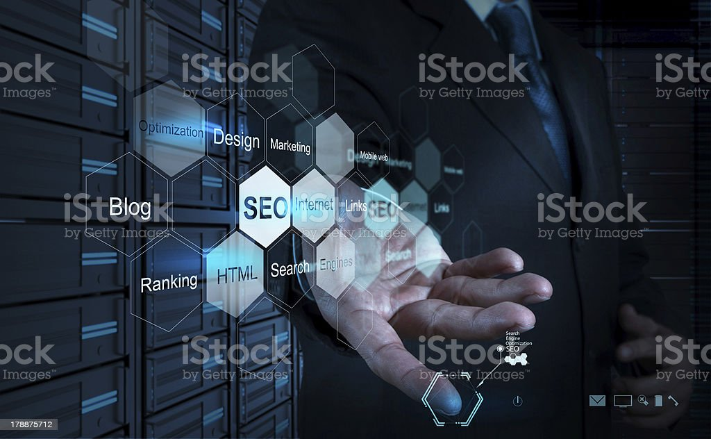 businessman hand showing search engine optimization as concept stock photo
