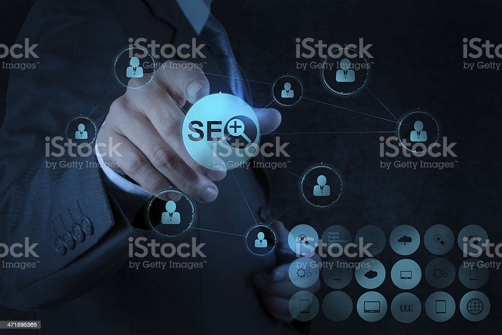 businessman hand showing search engine optimization SEO royalty-free stock photo
