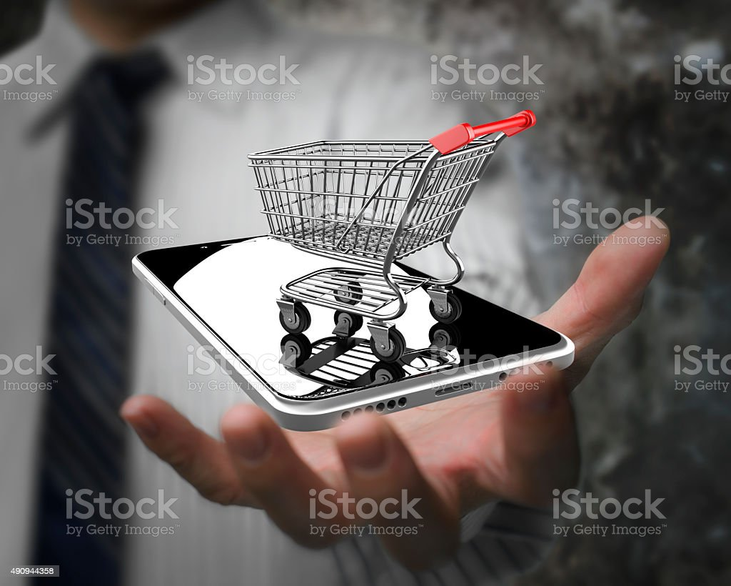 Businessman hand showing shopping cart with smart phone stock photo