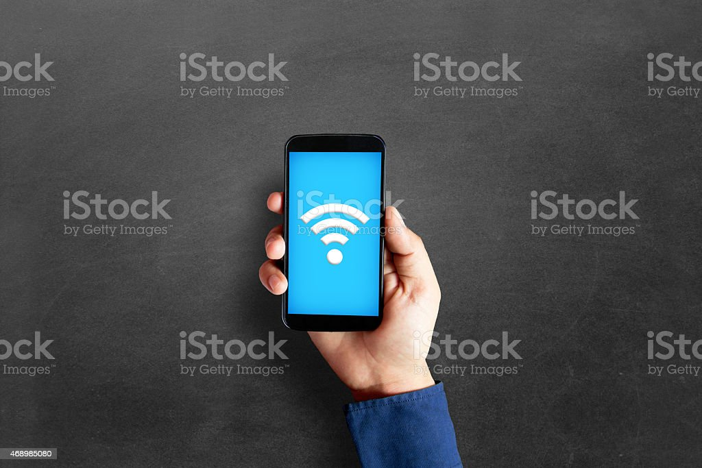 Businessman hand showing smart phone stock photo