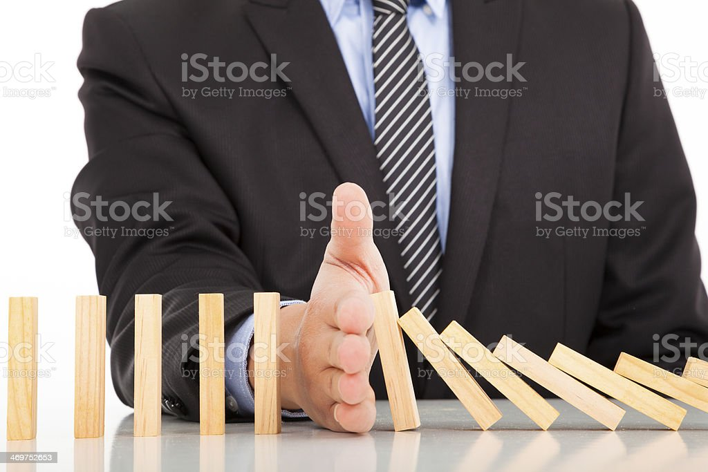 businessman hand stop dominoes continuous toppled stock photo