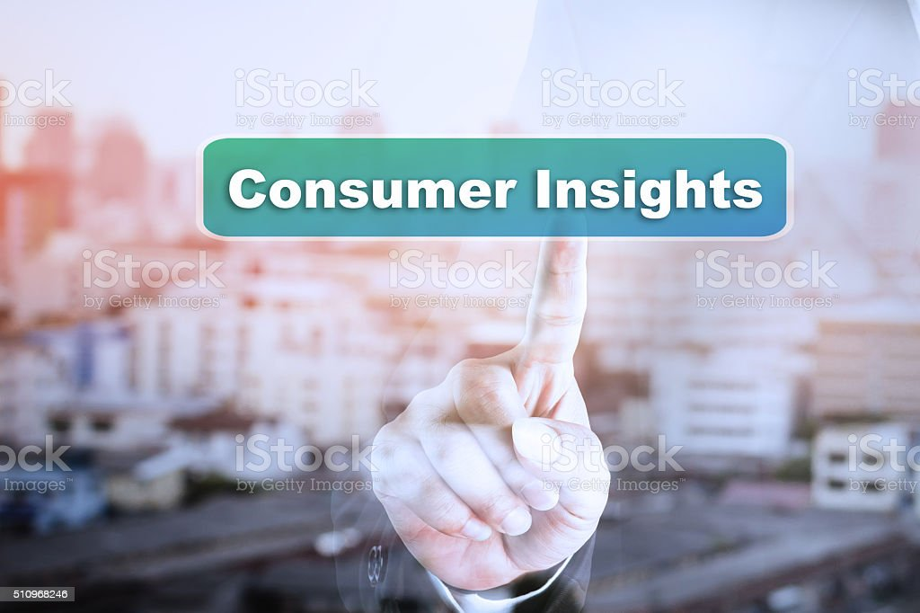 Businessman hand touch screen graph on Consumer Insights. stock photo