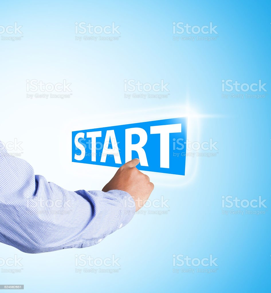 Businessman hand touch start text on abstract background stock photo
