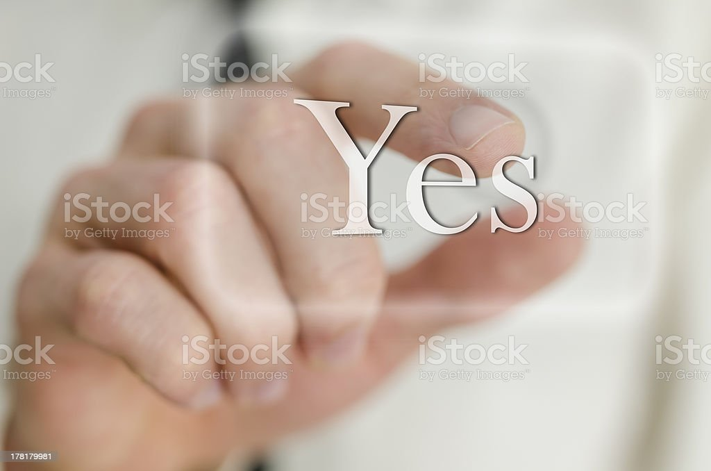 Businessman hand touching a Yes button royalty-free stock photo
