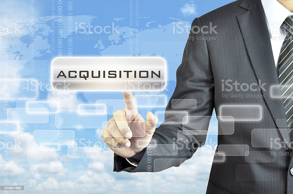 Businessman hand touching ACQUISITION word on virtual screen stock photo
