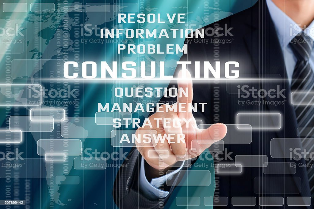 Businessman hand touching CONSULTING sign on virtual screen stock photo