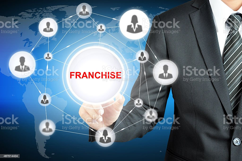 Businessman hand touching FRANCHISE sign on virtual screen stock photo