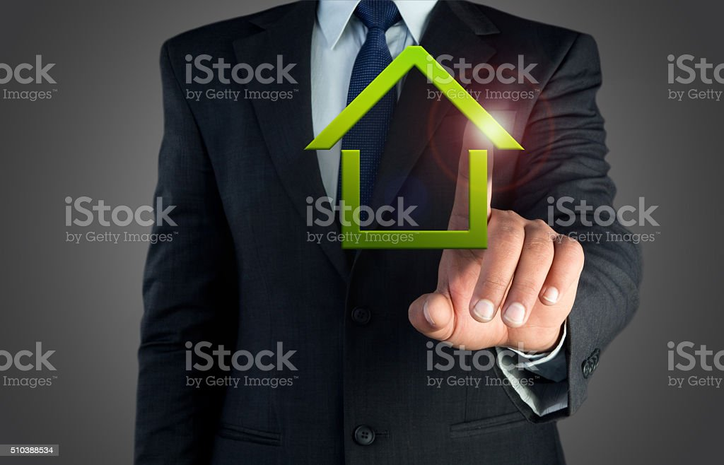 businessman hand touching home stock photo
