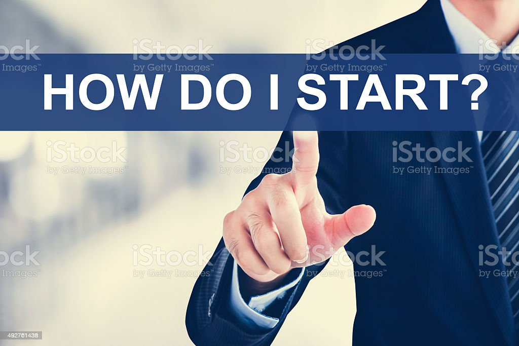 Businessman hand touching HOW DO I START? tab stock photo