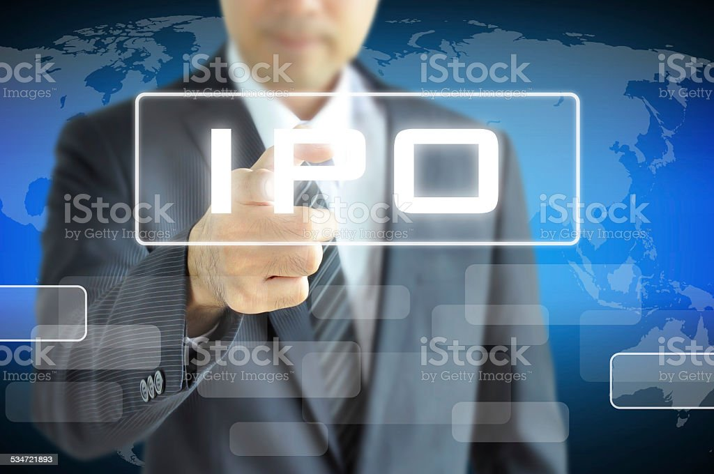 Businessman hand touching IPO (Initial Public Offering ) sign stock photo
