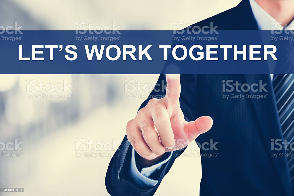 Businessman hand touching LET'S WORK TOGETHER message on virtual screen stock photo