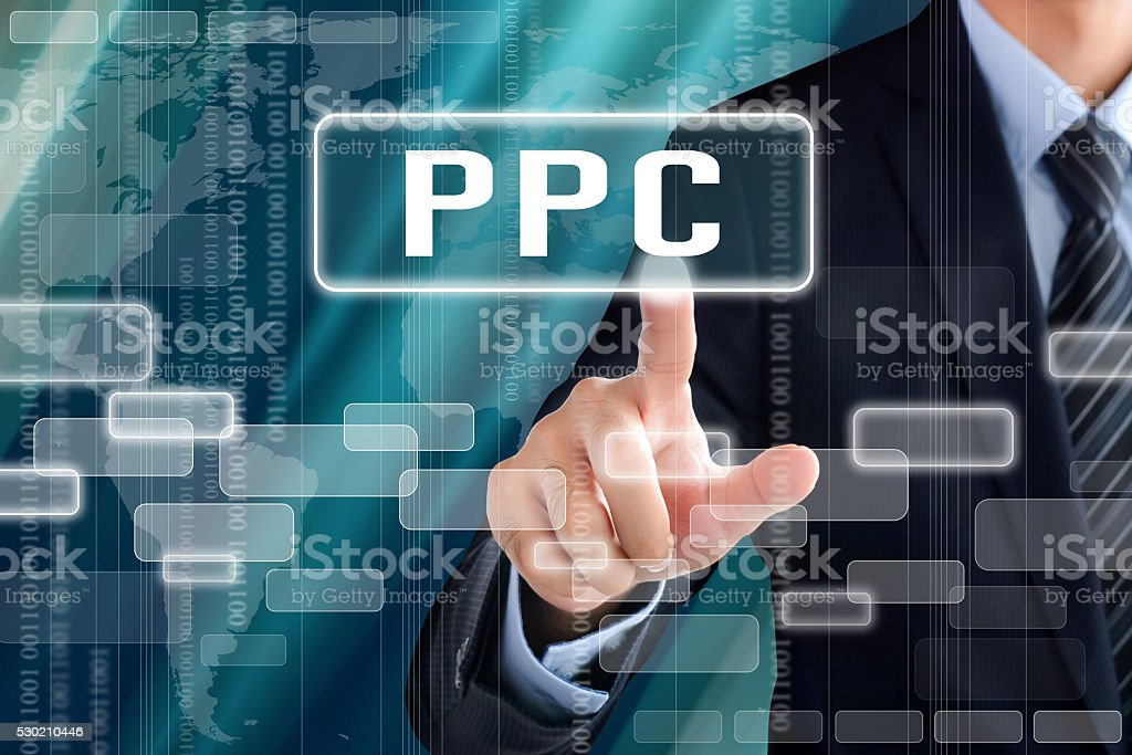 Businessman hand touching PPC (or Pay Per Click) sign stock photo