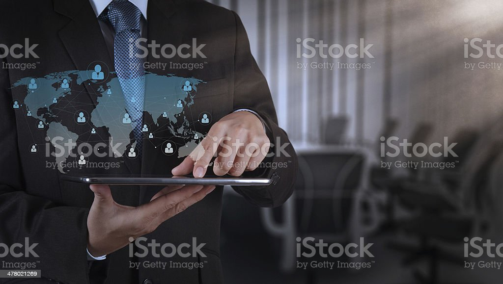 businessman hand using tablet computer and board room royalty-free stock photo