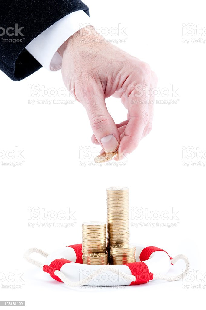 businessman hand with coins and lifebelt royalty-free stock photo