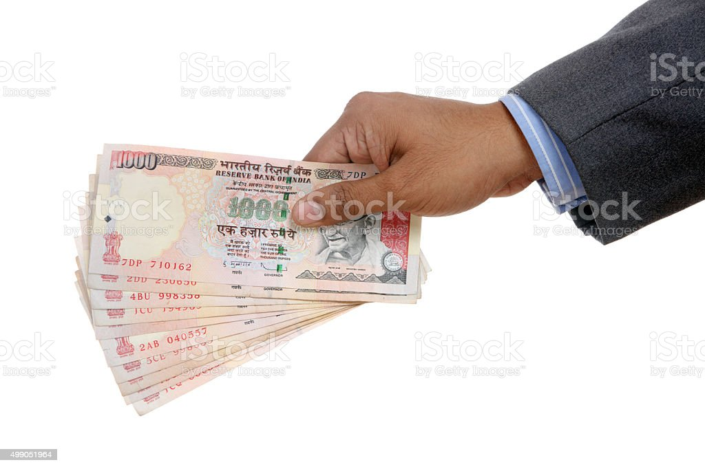 Businessman Hand with Indian thousand rupee notes stock photo
