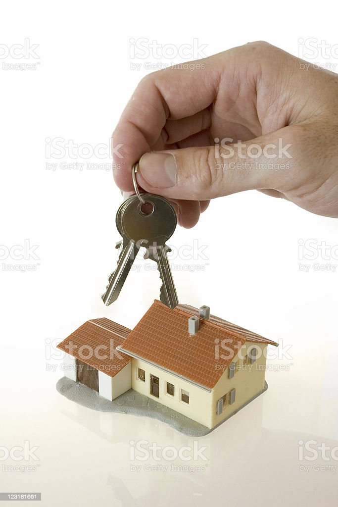 businessman hand with keys and a little house royalty-free stock photo