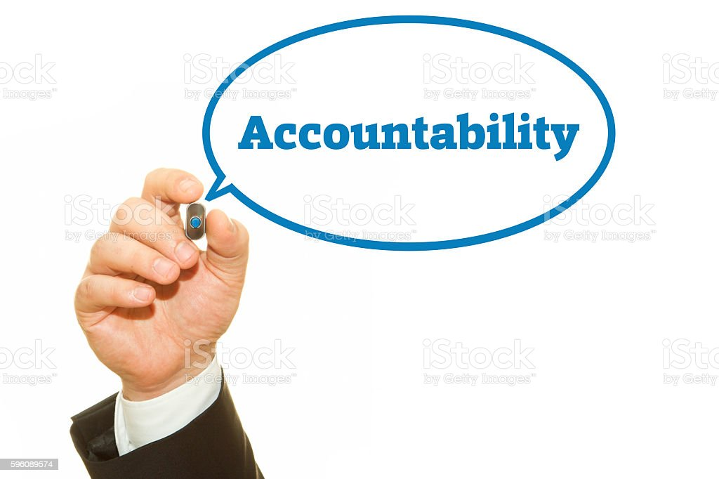 Businessman hand writing Accountability with a marker. stock photo