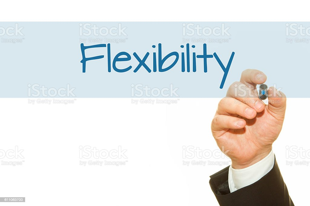 Businessman hand writing Flexibility word with a marker. stock photo