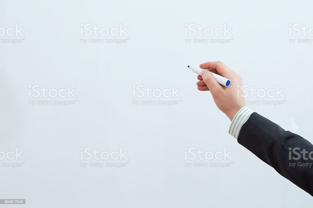 businessman hand writing on the whiteboard stock photo