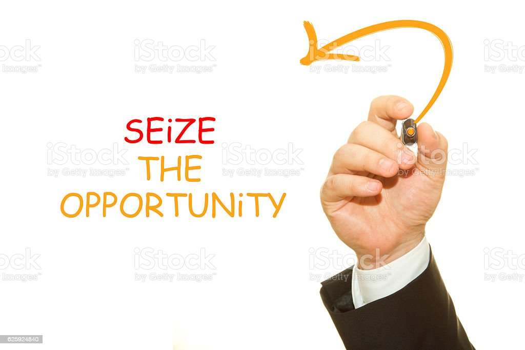 Businessman hand writing Seize the opportunity stock photo
