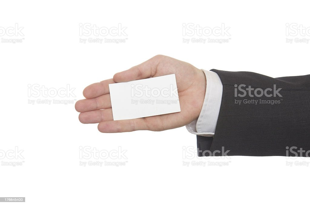 Businessman handing a blank business card over white royalty-free stock photo