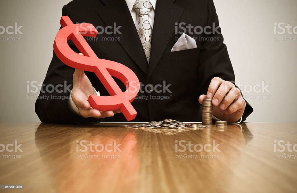 Businessman handing a dollar sign royalty-free stock photo
