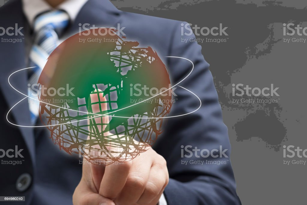 Businessman hands are touching the globe concept World Wide. stock photo