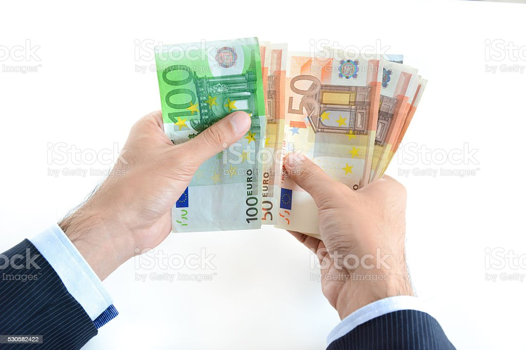 Businessman hands counting money, Euro currency (EUR) stock photo