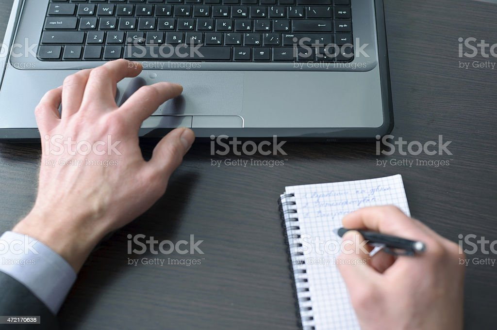 Businessman hands  doing some computer work stock photo