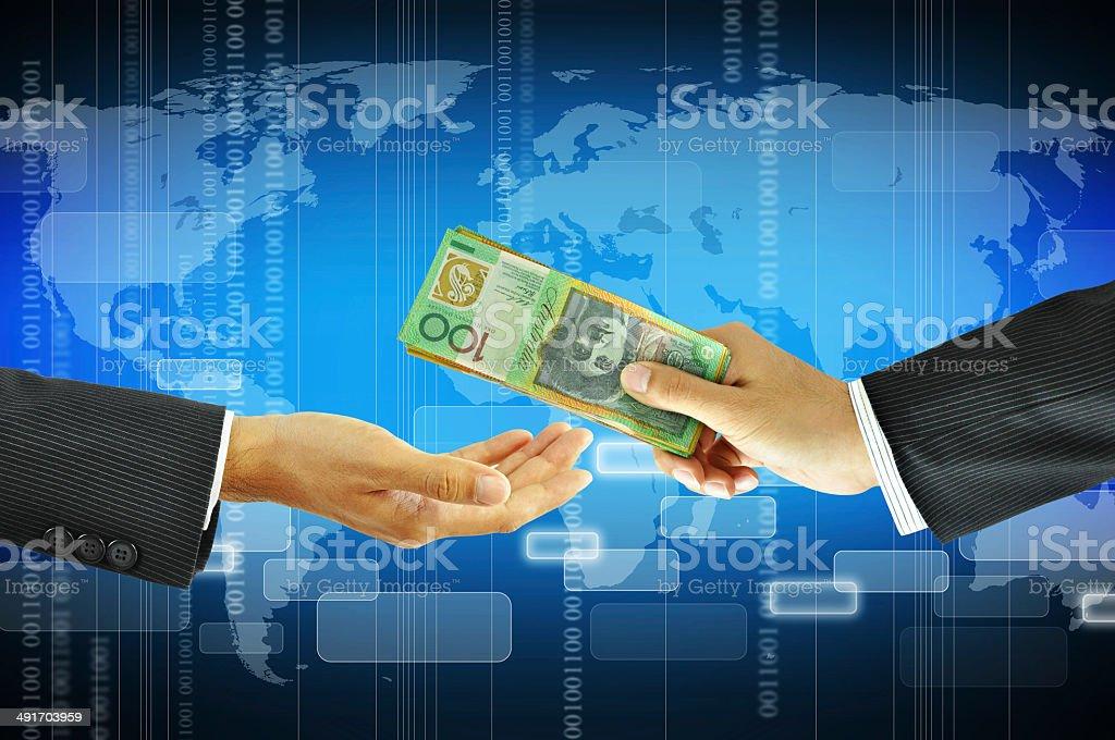 Businessman hands giving money - Australian dollars stock photo