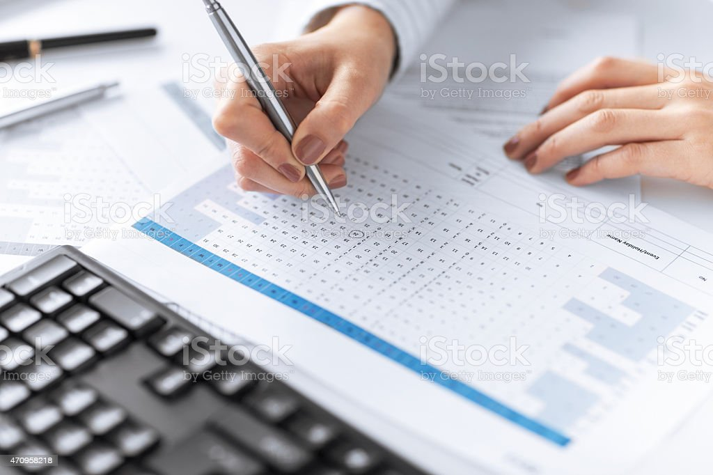 Businessman hands pointing at business document stock photo